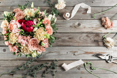 The florist desktop with working tools on gray old wooden background Stock Photography