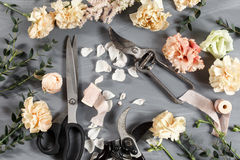 The florist desktop with working tools on gray wooden background. copy space Stock Photos