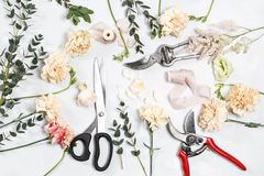 The florist desktop with working tools on white wooden background Stock Photo