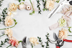 The florist desktop with working tools on white wooden background Royalty Free Stock Image