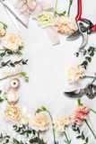 The florist desktop with working tools on white wooden background. copy space Stock Images