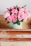 Florist did rich bunch flowers light background, wooden surface. green vase in box Stock Photo