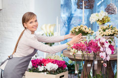 Florist by the flower pots Royalty Free Stock Photo