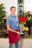 Florist in flower shop Stock Photo