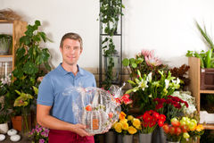 Florist in flower shop Royalty Free Stock Images