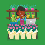Florist at flower shop vector illustration. An african-american florist using telephone and laptop to take order. Young florist standing at the counter at Royalty Free Stock Photography