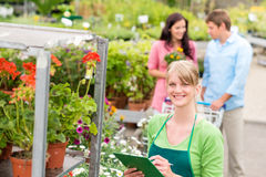 Florist at garden centre retail inventory. Female florist working at garden centre retail inventory Royalty Free Stock Image