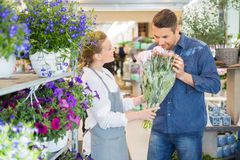 Florist Giving Customer To Smell Fresh Flower Bouquet Royalty Free Stock Photos
