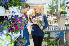 Florist Guiding Customer In Buying Flower Bouquet Stock Photography