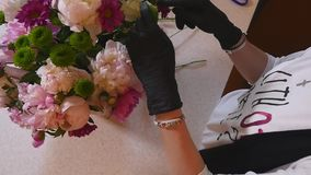 Florist hand make bouquets flowers in grey pot stock footage