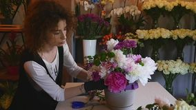 Florist hand make bouquets flowers in grey pot stock video