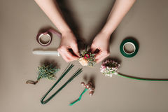 Florist hands creating bouquet of flowers Stock Images