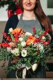 Florist hands holding bouquet flowers closeup. Royalty Free Stock Images