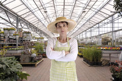 Florist with hat in greenhouse Royalty Free Stock Photography