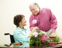 Florist - Helpful Husband Stock Photo