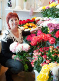 Florist in her small  flower shop Stock Images