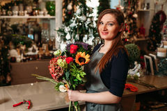 Florist with her work. Stock Photo