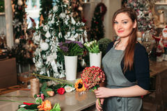 Florist with her work. Stock Image