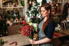 Florist with her work. Stock Photos