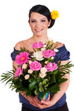 Florist holding beautiful roses arrangement Stock Photo