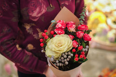 Florist holding bouquet colorful flowers shop assistant hands Royalty Free Stock Photography