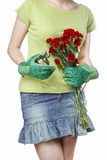 Florist holding bouquet of red carnations and garden shears. Royalty Free Stock Images