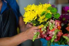 Florist Holding Bunch Of Flower In Florist Shop Stock Image