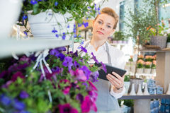 Florist Holding Digital Tablet While Standing By Royalty Free Stock Photo