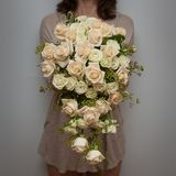 Florist holding wedding tear drop bouquet Royalty Free Stock Photography