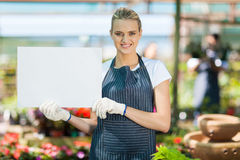 Florist holding white board Royalty Free Stock Images