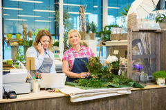 Florist Making Bouquet While Colleague Using Royalty Free Stock Image