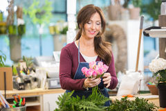 Florist Making Bouquet Of Pink Roses In Shop Stock Photos
