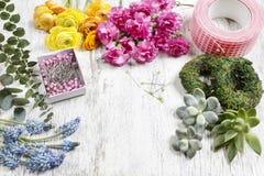 Florist making bouquet of ranunculus flowers Stock Images
