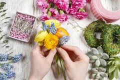 Florist making bouquet of ranunculus flowers Royalty Free Stock Images