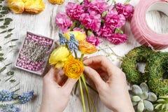 Florist making bouquet of ranunculus flowers Stock Photos