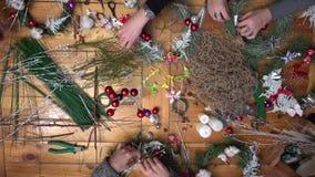 Florist making christmas door wreath. stock video