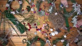Florist making christmas door wreath. stock video footage