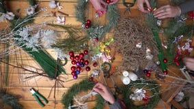 Florist making christmas door wreath. stock footage