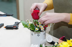 Florist making a composition of different cut Royalty Free Stock Photography