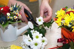 Florist making composition of different cut Stock Image