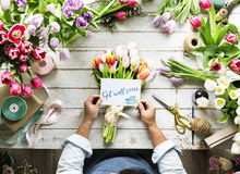 Florist Making Fresh Flowers Bouquet Arrangement with Get Well S. Oon Wishing Card Stock Image