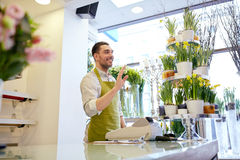 Florist man or seller at flower shop counter Stock Photography