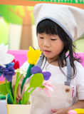Florist occupation role playing girl. Adorable asian girl role playing florist occupation wearing uniform Stock Photo