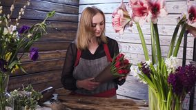 Florist in own flower shop, preparing bouquets. Hd stock video