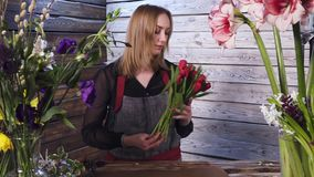 Florist in own flower shop, preparing bouquets. Hd stock video footage