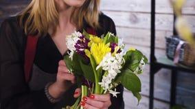 Florist in own flower shop, preparing bouquets. Hd stock video footage