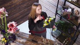Florist in own flower shop, preparing bouquets. Hd stock footage