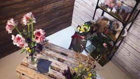 Florist in own flower shop, preparing bouquets. Hd stock video