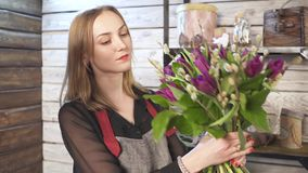 Florist in own flower shop, preparing bouquets. Hd stock footage