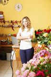 Florist. Portrait of flower shop owner standing in her shop. Small business royalty free stock image